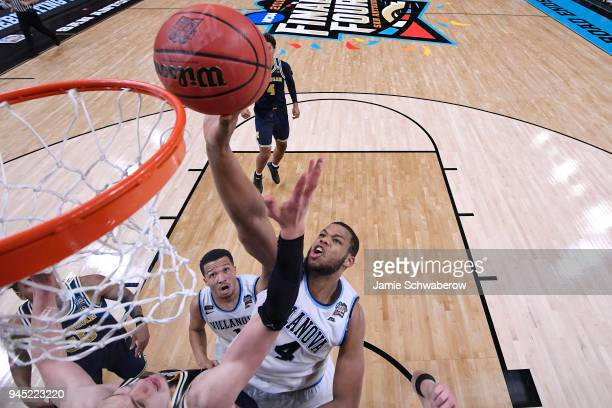 Omari Spellman of the Villanova Wildcats tips the ball in against the Michigan Wolverines during the 2018 NCAA Photos via Getty Images Men's Final...