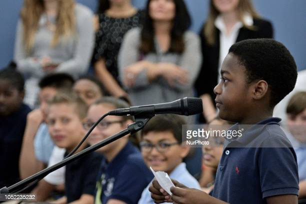 Omari Thomas stunted at Robert Pollack Elementary ask questions to candidates for the seat of Governor incumbent Tom Wolf and Scott Wagner at a forum...