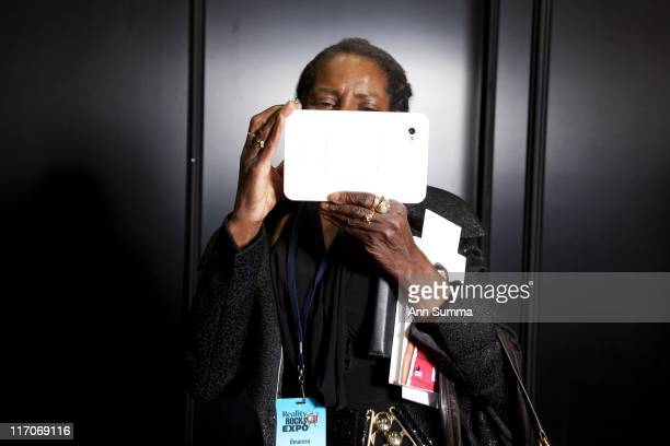 Omarosa's mother Moma Rosa plays with her iPad while waiting for Omarosa backstage in the VIP section at 'Reality Rocks Los Angeles' first reality...
