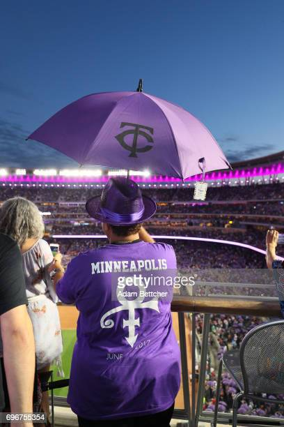 Omarr Baker helps celebrate Prince Night at Target Field a tribute to Minneapolis' own late musician organized by home team Minnesota Twins on June...