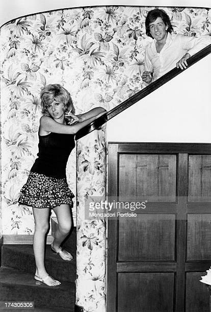 Ombretta Colli the pseudonym of Ombretta Comelli together with her husband Giorgio Gaber on their Milan home stairs the two Italian singers married...