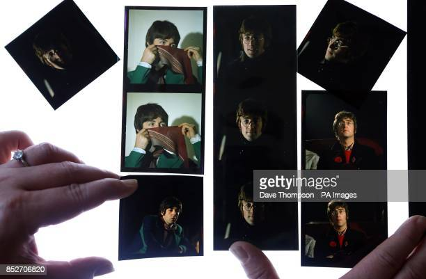 Omega Auctions salesroom manager Karen Fairweather lays out some of the unseen and unpublished images of The Beatles from late 1967/early 1968 during...