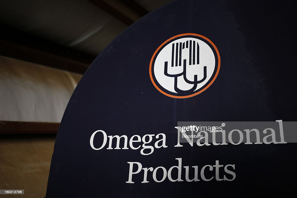 Omega National Products signage is displayed at the company's manufacturing facility in Louisville, Kentucky, U.S., on Tuesday, Sept. 10, 2013. The U.S. Federal Reserve is scheduled to release industrial production figures on Sept. 16. Photographer: Luke Sharrett/Bloomberg via Getty Images