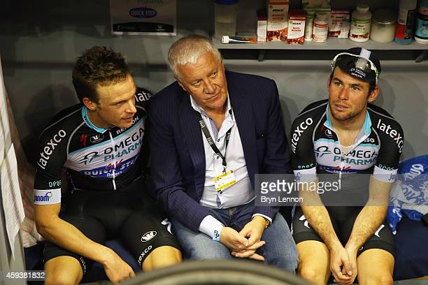 Omega Pharma-QuickStep boss Patrick Lefevere chats to Iljo Keisse of Belgium and team mate Mark Cavendish of Great Britain during day three of the...