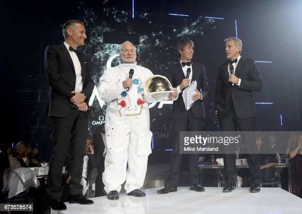 Omega President and CEO Raynald Aeschlimann Buzz Aldrin Prof Brian Cox and George Clooney on stage at the OMEGA 'Lost In Space' dinner to celebrate...