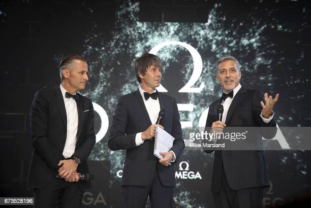 Omega President and CEO Raynald Aeschlimann Prof Brian Cox and George Clooney on stage at the OMEGA 'Lost In Space' dinner to celebrate the 60th...
