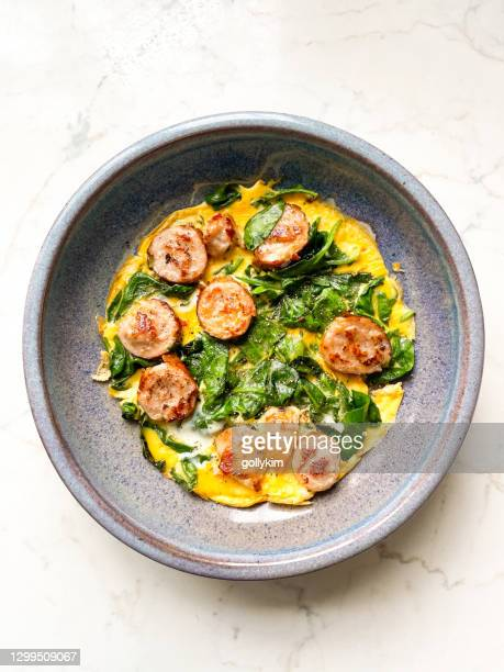 omelet frittata with sausage and spinach - sausage stock pictures, royalty-free photos & images