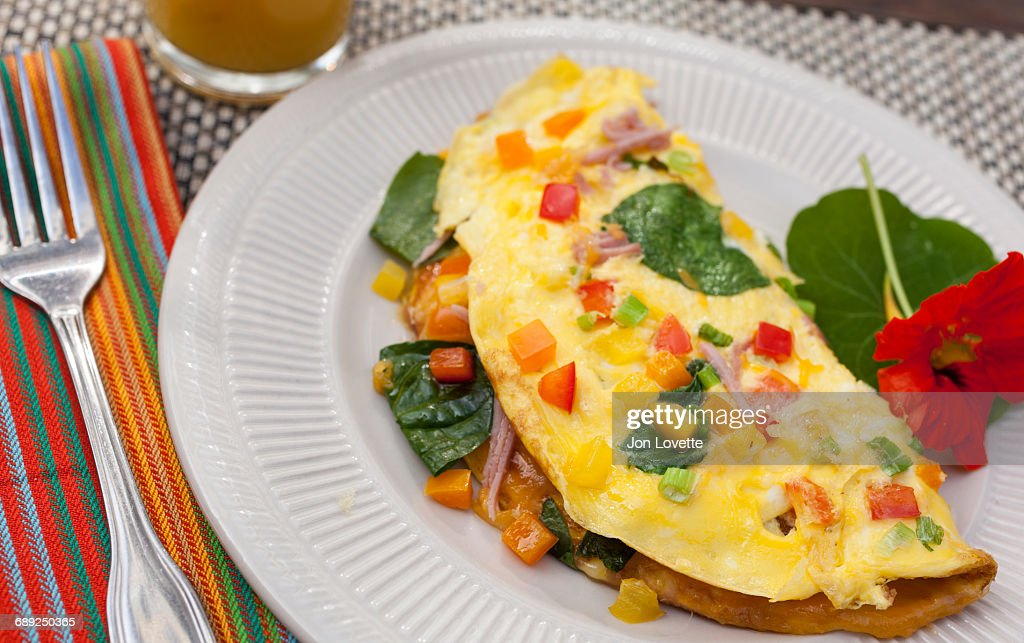 Omelet with ham, peppers, spinach and cheese : Stock Photo