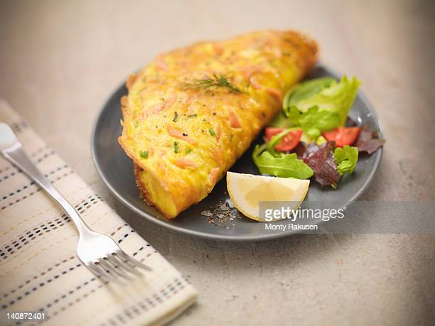 Omelet with Scottish smoked salmon, salad and lemon slice