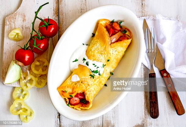 omelette filled with lecso - low carb diet stock pictures, royalty-free photos & images