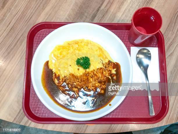omelettes with demi-glacé sauce - yōshoku photos et images de collection