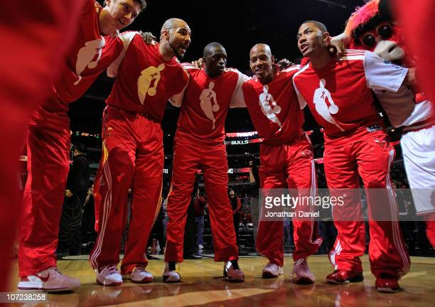 Omer Asik Carlos Boozer Loul Deng Keith Bogans and Derrick Rose of the Chicago Bulls gather in a huddle after player introductions before a game...