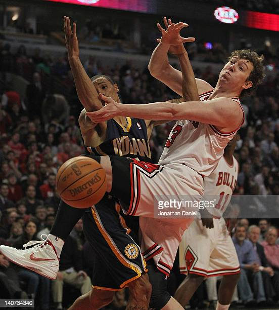 Omer Asik of the Chicago Bulls and George Hill of the Indiana Pacers battle for a rebound at the United Center on March 5 2012 in Chicago Illinois...