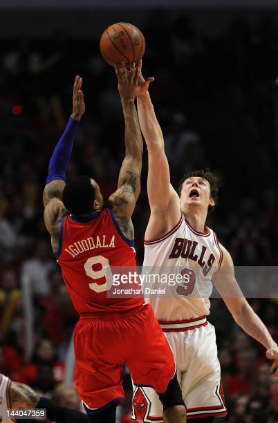 Omer Asik of the Chicago Bulls blocks a shot by Andre Iguodala of the Philadelphia 76ers in Game Five of the Eastern Conference Quarterfinals during...