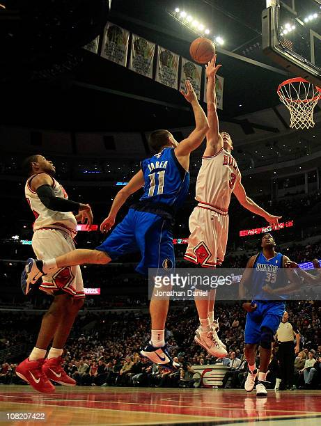 Omer Asik of the Chicago Bulls blocks a shot by Jose Barea of the Dallas Mavericks at the United Center on January 20, 2011 in Chicago, Illinois....