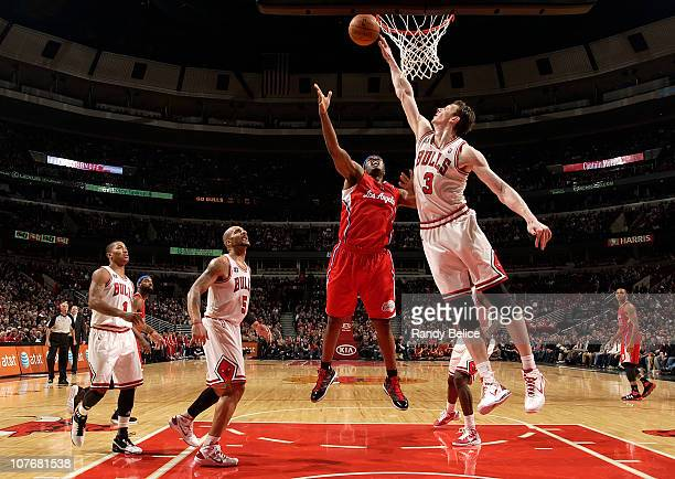 Omer Asik of the Chicago Bulls blocks the shot from Craig Smith of the Los Angeles Clippers as teammates Carlos Boozer and Derrick Rose look on...
