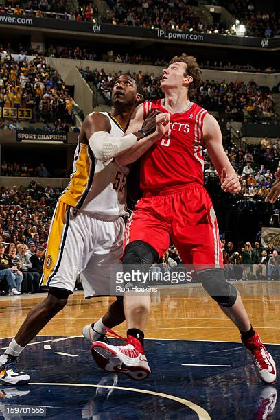 Omer Asik of the Houston Rockets battles for rebound position against Roy Hibbert of the Indiana Pacers of the Indiana Pacers of the Houston Rockets...