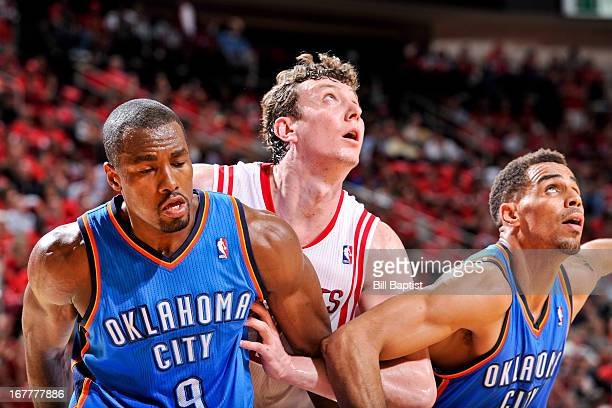 Omer Asik of the Houston Rockets battles for rebound position against Serge Ibaka and Thabo Sefolosha of the Oklahoma City Thunder in Game Four of...