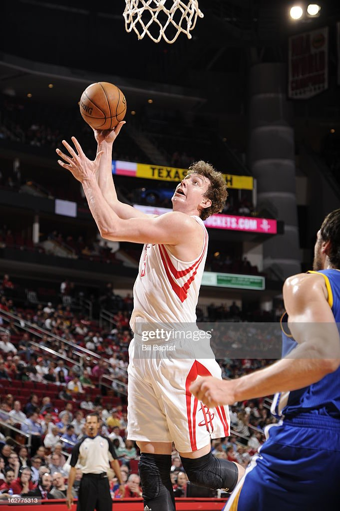 Omer Asik #3 of the Houston Rockets drives to the basket against the Golden State Warriors on February 5, 2013 at the Toyota Center in Houston, Texas.