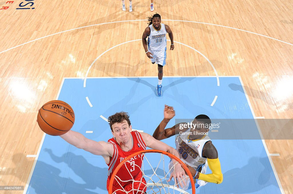 Omer Asik #3 of the Houston Rockets dunks against the Denver Nuggets on April 9, 2014 at the Pepsi Center in Denver, Colorado.