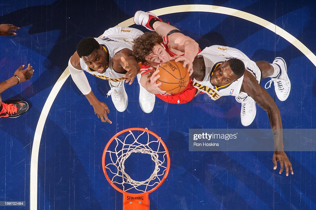 Omer Asik #3 of the Houston Rockets grabs a rebound against Ian Mahinmi #28 and Lance Stephenson #1 of the Indiana Pacers on January 18, 2013 at Bankers Life Fieldhouse in Indianapolis, Indiana.