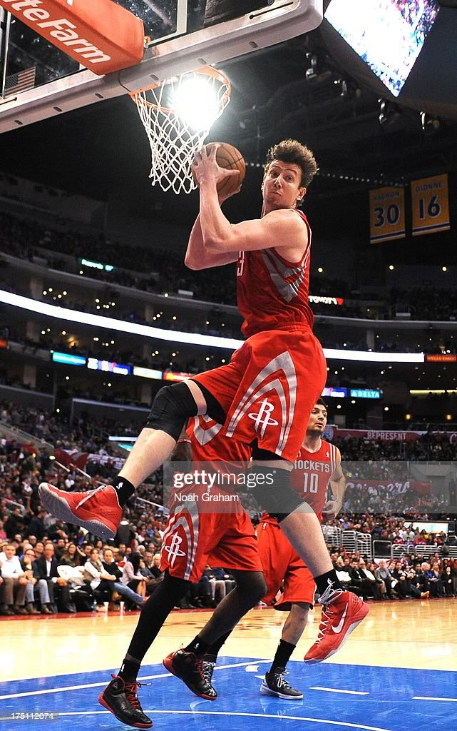 Omer Asik #3 of the Houston Rockets grabs a rebound during the game between the Los Angeles Clippers and the Houston Rockets at Staples Center on February 13, 2013 in Los Angeles, California.