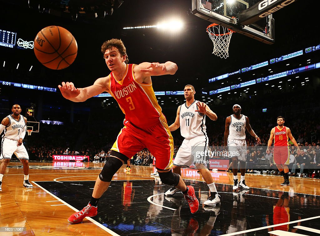 Omer Asik #3 of the Houston Rockets loses the ball as Brook Lopez #11 of the Brooklyn Nets watches during their game at the Barclays Center on February 22, 2013 in the Brooklyn borough of New York City.