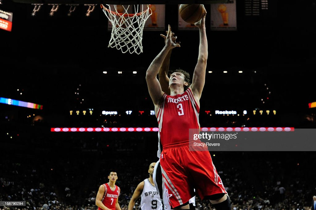Omer Asik #3 of the Houston Rockets scores against the San Antonio Spurs during a game at AT&T Center on December 28, 2012 in San Antonio, Texas. San Antonio won the game 122-116.
