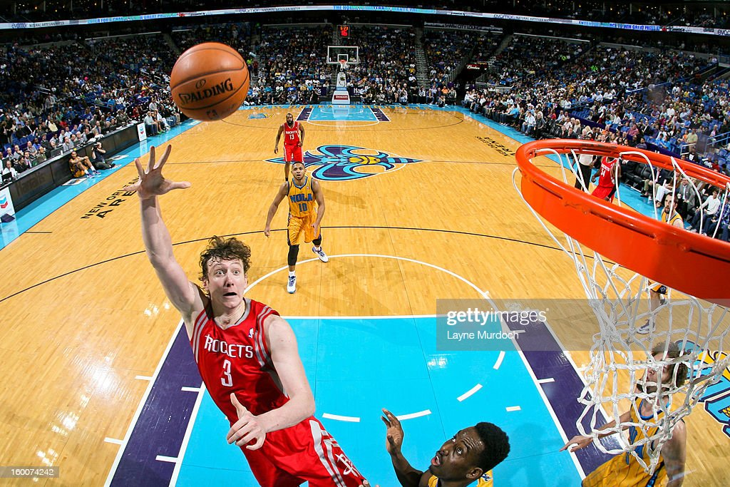 Omer Asik #3 of the Houston Rockets shoots in the lane against Al-Farouq Aminu #0 of the New Orleans Hornets on January 25, 2013 at the New Orleans Arena in New Orleans, Louisiana.