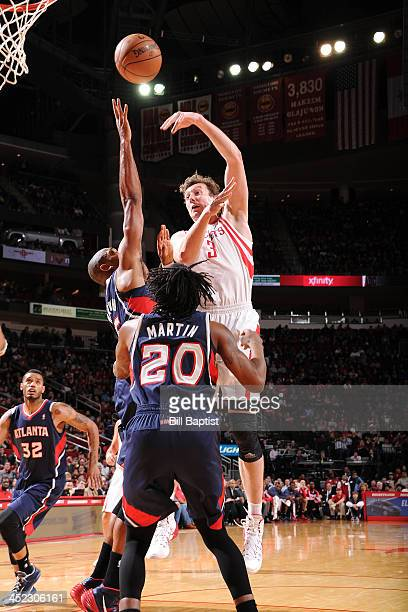 Omer Asik of the Houston Rockets shoots the ball against the Atlanta Hawks on November 27 2013 at the Toyota Center in Houston Texas NOTE TO USER...
