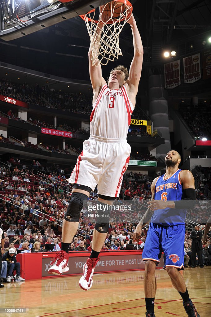 Omer Asik #3 of the Houston Rockets shoots the ball over Tyson Chandler #6 of the New York Knicks on November 23, 2012 at the Toyota Center in Houston, Texas.