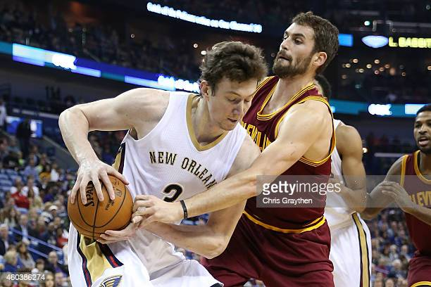 Omer Asik of the New Orleans Pelicans fights for a ball with Kevin Love of the Cleveland Cavaliers at Smoothie King Center on December 12 2014 in New...