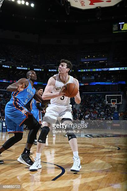 Omer Asik of the New Orleans Pelicans handles the ball against the Oklahoma City Thunder during the game on December 2 2014 at the Smoothie King...