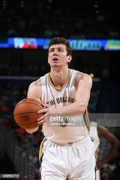 Omer Asik of the New Orleans Pelicans shoots a free throw against the Oklahoma City Thunder during the game on December 2 2014 at the Smoothie King...