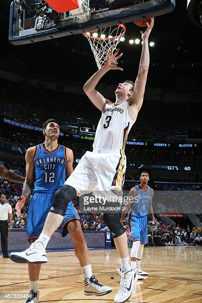 Omer Asik of the New Orleans Pelicans shoots against the Oklahoma City Thunder at the Smoothie King Center on October 16 2014 in New Orleans...