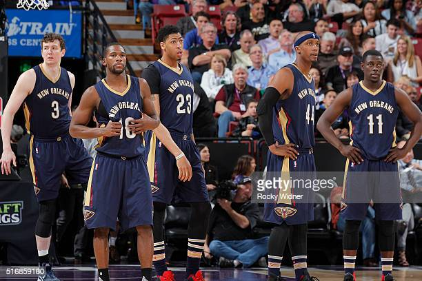Omer Asik Toney Douglas Anthony Davis Dante Cunningham and Jrue Holiday of the New Orleans Pelicans face off against the Sacramento Kings on March 16...