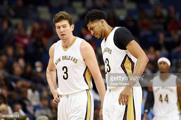 Omer Asik watches as Anthony Davis of the New Orleans Pelicans leaves the court with a back injury during the first half of a game against the...