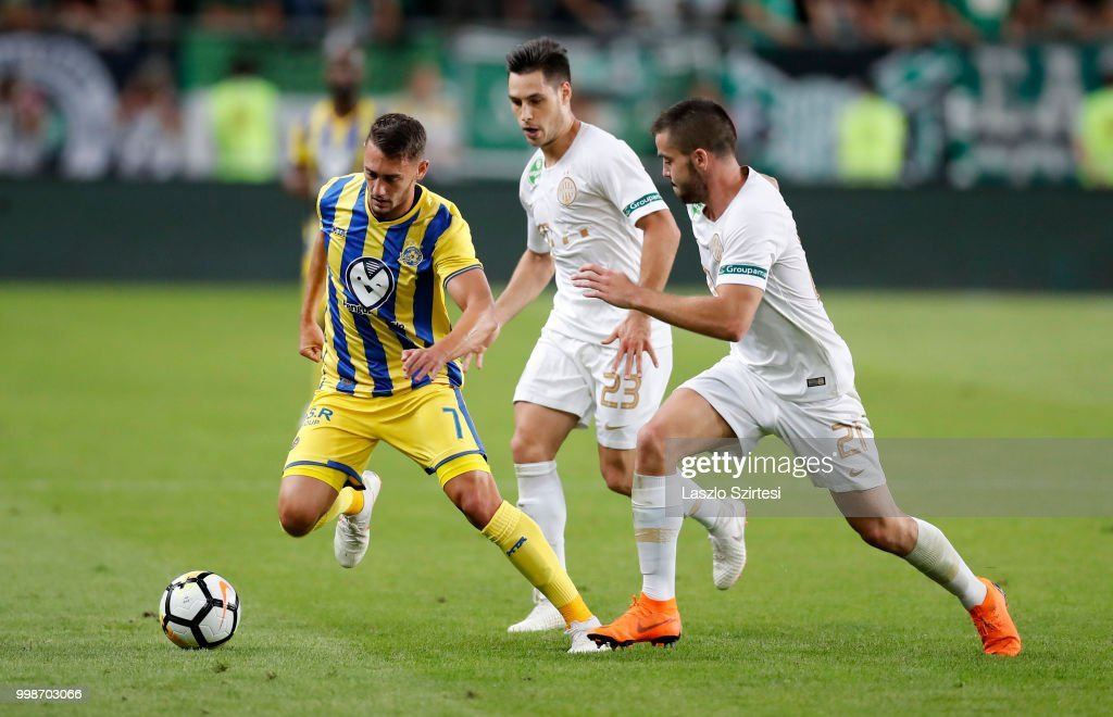 Omer Atzili of Maccabi Tel Aviv FC competes for the ball with Lukacs Bole of Ferencvarosi TC and Endre Botka of Ferencvarosi TC during the UEFA Europa League First Qualifying Round 1st Leg match between Ferencvarosi TC and Maccabi Tel Aviv FC at Groupama Arena on July 12, 2018 in Budapest, Hungary.