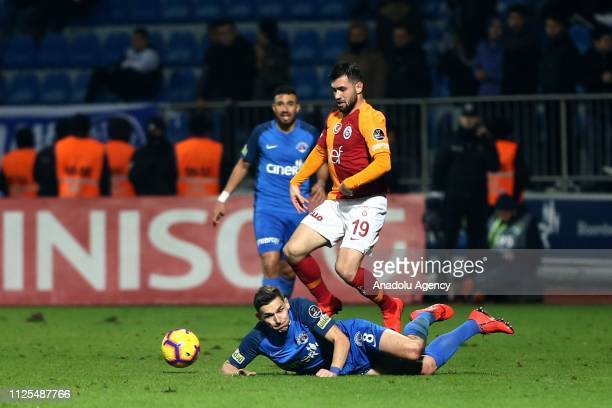 Omer Bayram of Galatasaray competes with David Pavelka of Kasimpasa during the Turkish Super Lig soccer match between Kasimpasa and Galatasaray at...
