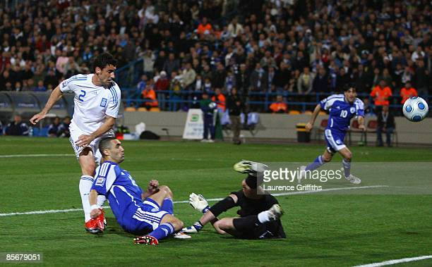 Omer Golan of Israel scores the equalising goal past Konstantinos Chalkias of Greece duing the FIFA 2010 World Cup Qualifier between Israel and...