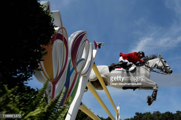 Omer Karaevli of Turkey riding Cheston de la Pomme d'Or Z competes during Day 5 of the Longines FEI Jumping European Championship, Round 2 Team...