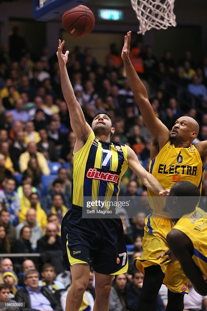 Omer Onan, #7 of Fenerbahce Ulker Istanbul competes with Devin Smith, #6 of Maccabi Electra Tel Aviv during the 2012-2013 Turkish Airlines Euroleague Top 16 Date 3 between Maccabi Electra Tel Aviv v Fenerbahce Ulker Istanbul at Nokia Arena on January 10, 2013 in Tel Aviv, Israel.