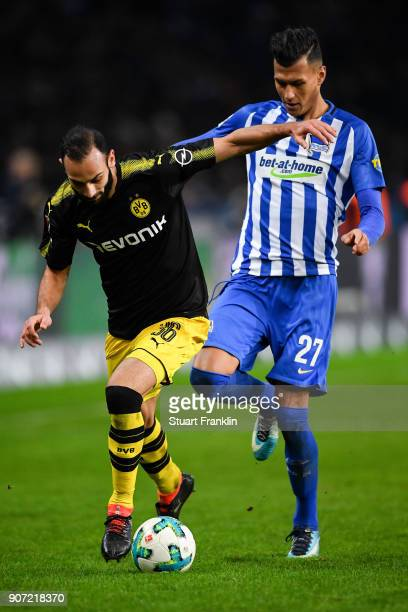 Omer Toprak of Borussia Dortmund and Davie Selke of Hertha Berlin battle for the ball during the Bundesliga match between Hertha BSC and Borussia...