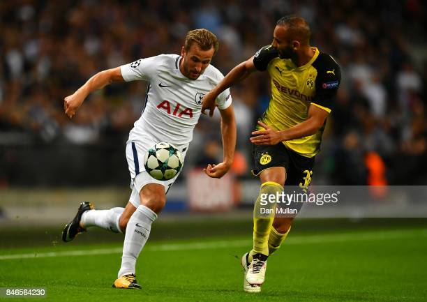 Omer Toprak of Borussia Dortmund and Harry Kane of Tottenham Hotspur battle for posession during the UEFA Champions League group H match between...
