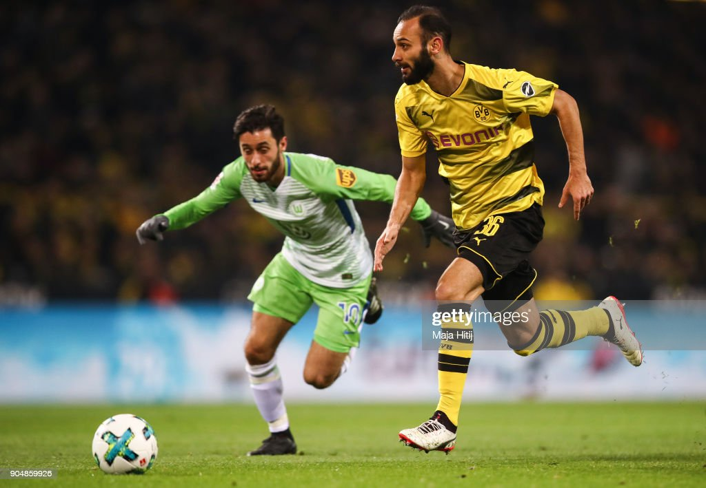 Omer Toprak #36 of Borussia Dortmund and Yunus Malli #10 of VfL Wolfsburg battle for the ball during the Bundesliga match between Borussia Dortmund and VfL Wolfsburg at Signal Iduna Park on January 14, 2018 in Dortmund, Germany.