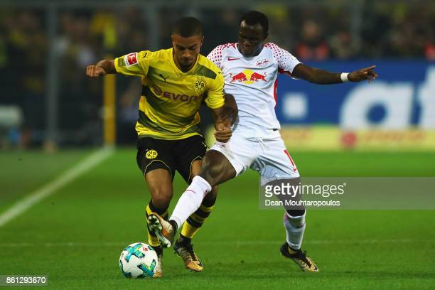 Omer Toprak of Borussia Dortmund battles for the ball with Bruma of RB Leipzig during the Bundesliga match between Borussia Dortmund and RB Leipzig...