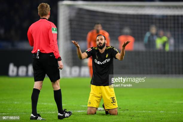 Omer Toprak of Borussia Dortmund reacts to referee Christian Dingert during the Bundesliga match between Hertha BSC and Borussia Dortmund at...