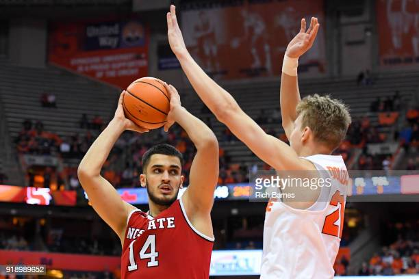 Omer Yurtseven of the North Carolina State Wolfpack controls the ball as Marek Dolezaj of the Syracuse Orange defends during the second half at the...