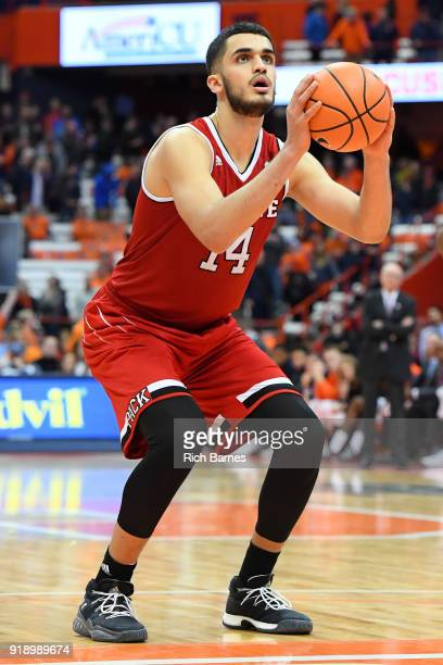 Omer Yurtseven of the North Carolina State Wolfpack shoots a free throw against the Syracuse Orange during the second half at the Carrier Dome on...