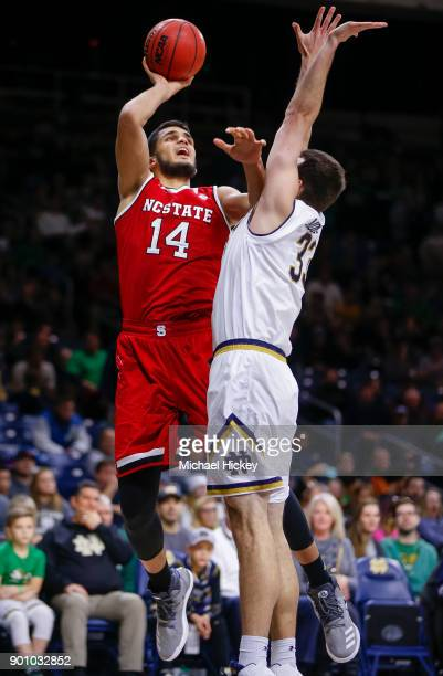 Omer Yurtseven of the North Carolina State Wolfpack shoots the ball against John Mooney of the Notre Dame Fighting Irish at Purcell Pavilion on...